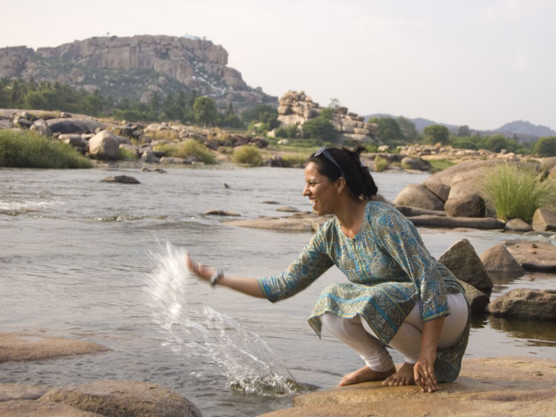 Living it off on the banks of the Tungabhadra. The Anjanagiri Mountain can be seen in the distance.